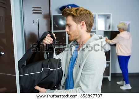 sportsman taking bag from locker #656897707