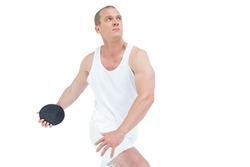 Sportsman throwing shot put on white background