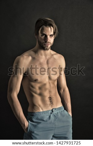 Sportsman with sexy torso and chest. Man with six pack and ab muscles. Training and workout activity in gym. Athlete with fit body in shorts. Sport or fitness and bodycare concept, vintage filter.
