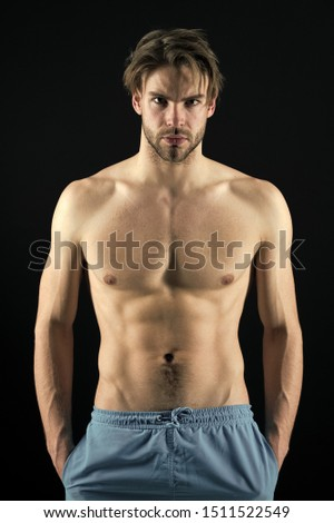 Sportsman with six pack and ab muscles. Macho with sexy torso and chest. Man bodybuilder with fit body. Training and workout activity in gym. Sport or fitness and bodycare concept.