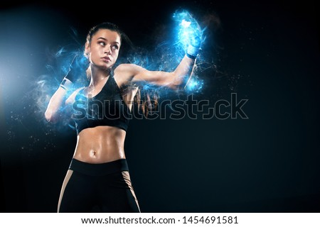Sportsman, woman boxer fighting in gloves on black background. Boxing and fitness concept. Energy and motivation.