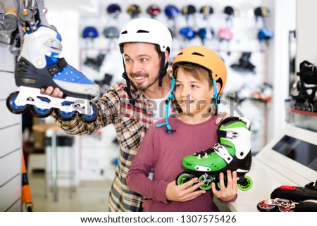 Sportsmen are searching comfortable roller-skates in store.