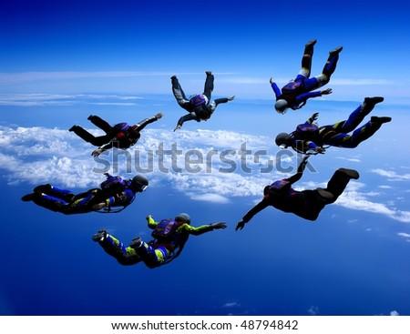 Sportsmen-parashutist soaring in sky