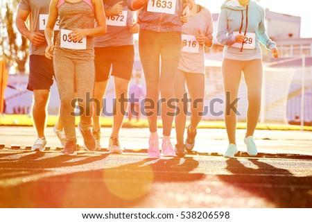 Sportsmen running at stadium #538206598