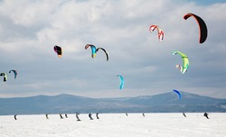 Sportsmen snowkiting at sport winter competition