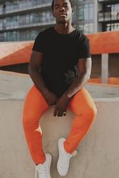 Sportswear black t-shirt with orange pants cool men's fashion
