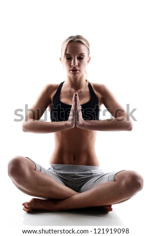 sporty and attractive woman do yoga exercise isolated on a white