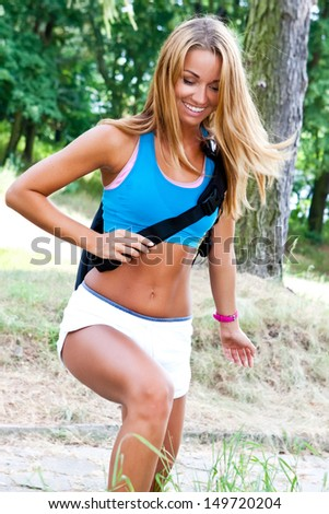 sporty and attractive woman with backpack