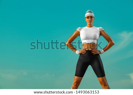 Sporty and fit young woman athlete relaxed after yoga training on the sky background. The concept of a healthy lifestyle and sport. Individual sports recreation. #1493063153