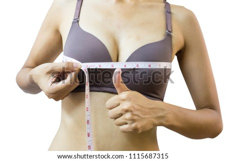 Sporty Asian woman measuring up her chest isolated on white background,clipping path. happy girl checking her breast measurement. Medical Breast enhancement,Breast Surgery or beautiful fashion concept