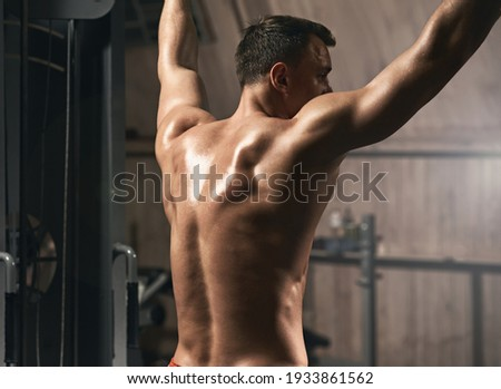 Sporty athletic man doing chin ups for arms and back muscles ストックフォト ©