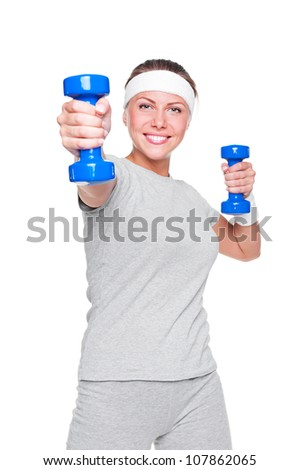 sporty attractive woman doing exercises with blue dumbbells over white background
