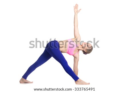 Sporty attractive young blond woman doing side bend, Parivrtta Trikonasana posture, Revolved Triangle Pose, studio full length isolated shot, profile view on white background #333765491