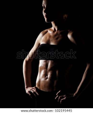 Sporty belly over dark background