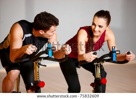 Sporty couple exercising at the fitness gym - stock photo