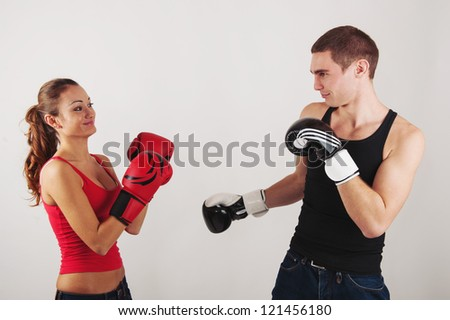 Sporty couple fighting with boxing gloves.