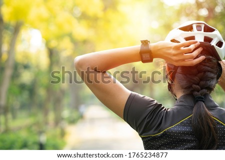 Sporty girl biker posing with bike helmet bicycle on sunny day. Outdoor sport activity, lifestyle concept Stock photo ©
