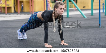 Sporty girl doing abs exercises