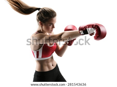Sporty girl doing boxing exercises, making direct hit. Photo of young girl isolated on white background. Strength and motivation.