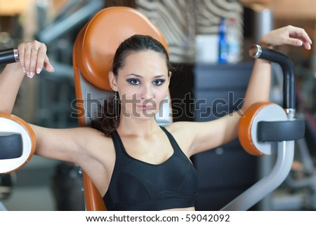 Sporty Girl in fitness hall, healthy concept