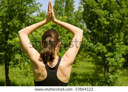 Sporty girl making yoga outdoors