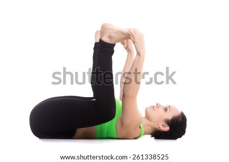 sporty girl on white background lying in yoga happy baby