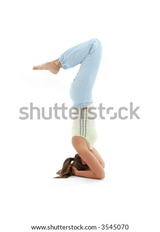 sporty girl practicing salamba sirsasana supported headstand
