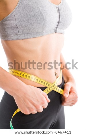 Sporty lean woman measuring waist. From bust to crotch.