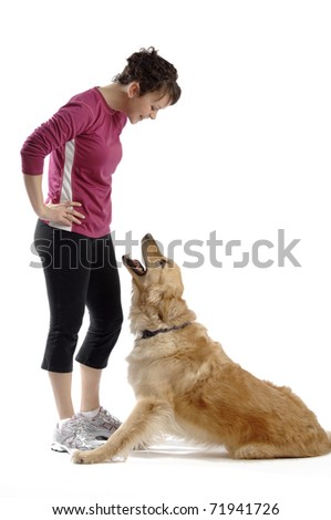 Sporty looking girl plays with her dog. - stock photo