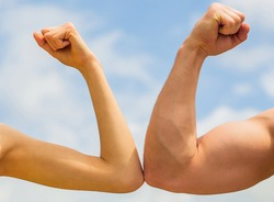 Sporty man and woman. Muscular arm vs weak hand. Vs, fight hard. Competition, strength comparison. Rivalry concept. Rivalry, vs, challenge, strength comparison.