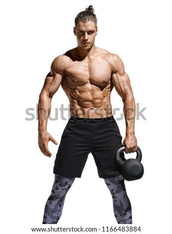 Sporty man resting after workout with kettlebell. Photo of handsome man with naked torso and good physique on white background. Strength and motivation