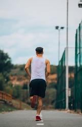 Sporty man running fast. Sport, athletics, fitness, jogging activity