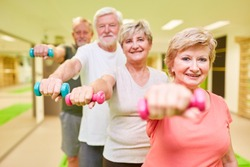 Sporty senior group with dumbbells for rehabilitation for muscle building and strength