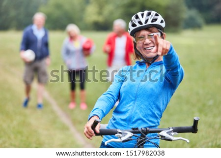 Sporty senior woman on a mountain bike full of motivation and vitality
