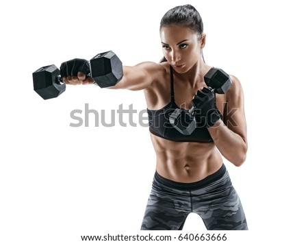 Stock Photo Sporty woman doing boxing exercises, making direct hit with dumbbells. Photo of muscular female wearing sportswear on white background. Strength and motivation