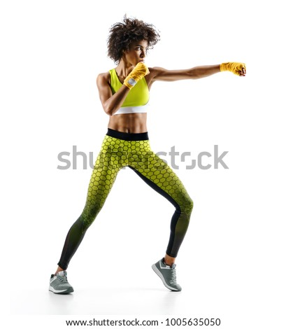 Stock Photo Sporty woman during boxing exercise making direct hit. Photo of boxer on white background. Strength and motivation