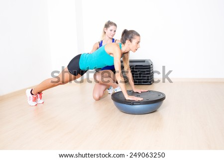 sporty woman in gym with female coach