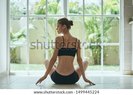Sporty woman indoors hobby relaxation meditation relaxation calm