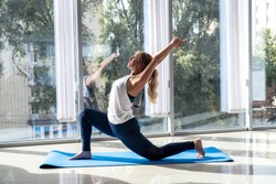 sporty woman relax exercising on yoga mat, rehabilitation fitness.  healthy lifestyle