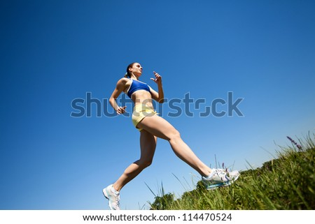 sporty woman running outdoor