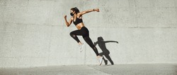 Sporty woman running outdoors. Female in sportswear sprinting in morning.