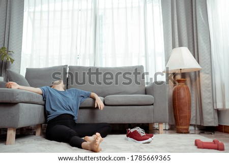 Sporty young asian woman tired doing sport exercises sitting on floor between exercise in the living room, Sport training online fitness class, Home workout healthy lifestyle. Photo stock ©
