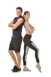Sporty young couple on white background