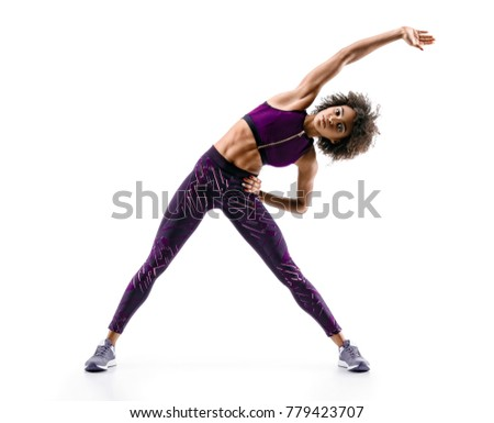 Stock Photo Sporty young woman doing  fitness exercise abs isolated on white background. Concept of healthy life. Full length