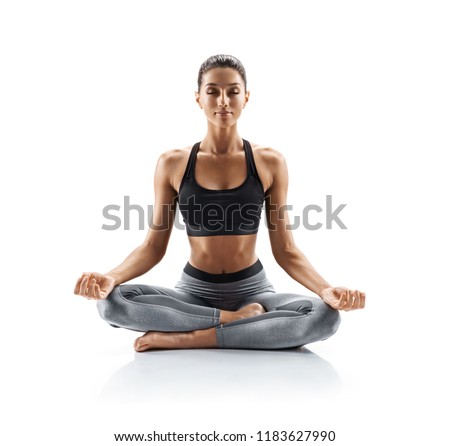 Sporty young woman doing yoga practice isolated on white background. Concept of healthy life and natural balance between body and mental development. Full length stock photo