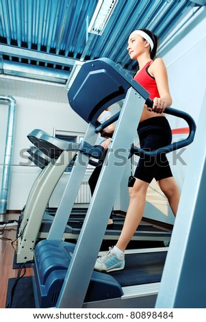 Sporty young woman in the gym centre. - stock photo