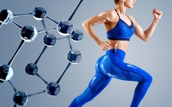 Sporty young woman runing and jumping near glass molecules. Metabolism concept.