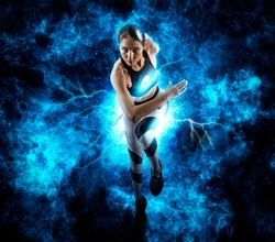 Sporty young woman running on blue background. Lightning effect