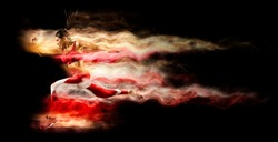 Sporty young woman running on red smoke background