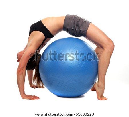 Sporty young woman with blue ball.